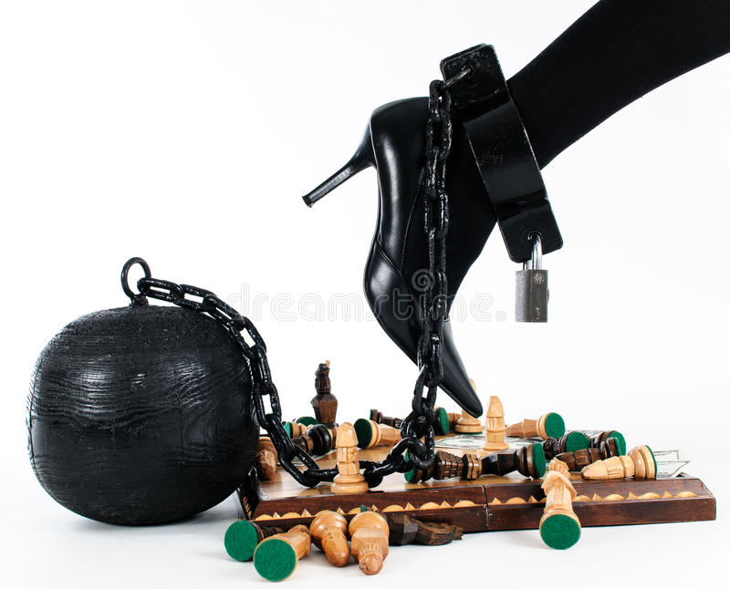 Female leg chained to the prison ball royalty free stock photography