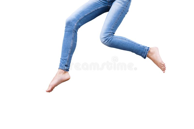 Female legs in blue fashion jeans isolated on white background.Top view and copy space. stock photos