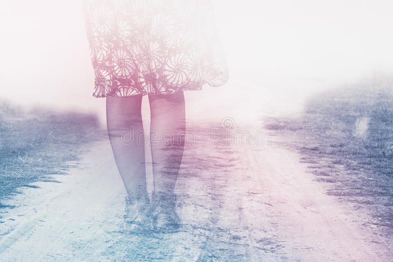 Female Legs on Country Road. To Nowhere, Anxiety Concept, Double Exposure, Vintage Retro Tone Effect stock photos