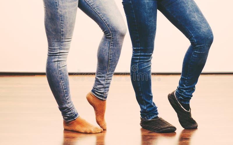 Female legs in denim pants and socks. Female legs in blue denim pants and socks stock photos