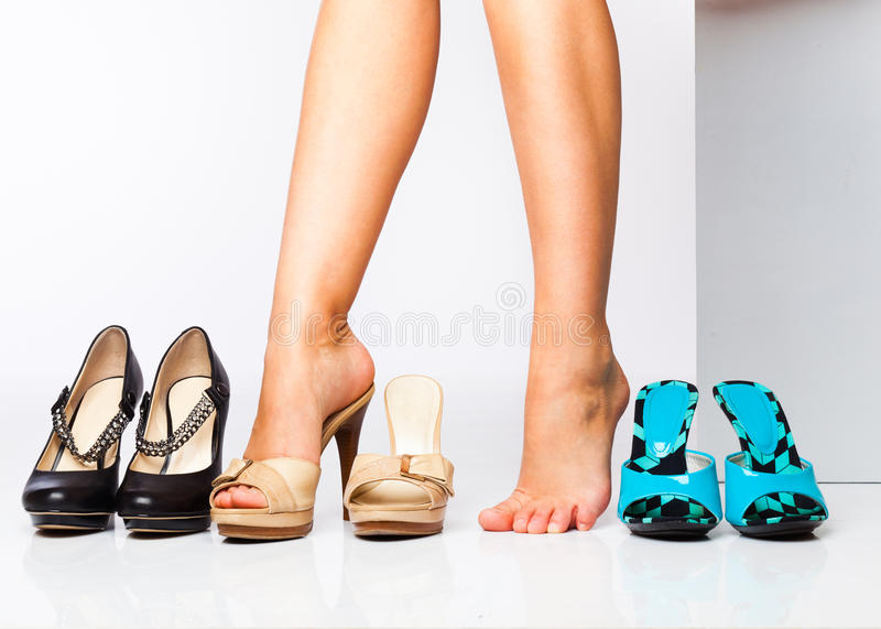 Female legs in fashion shoes royalty free stock image