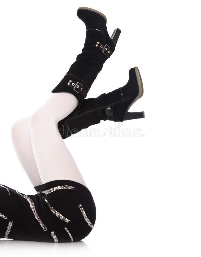 Female legs in high boots close-up stock image