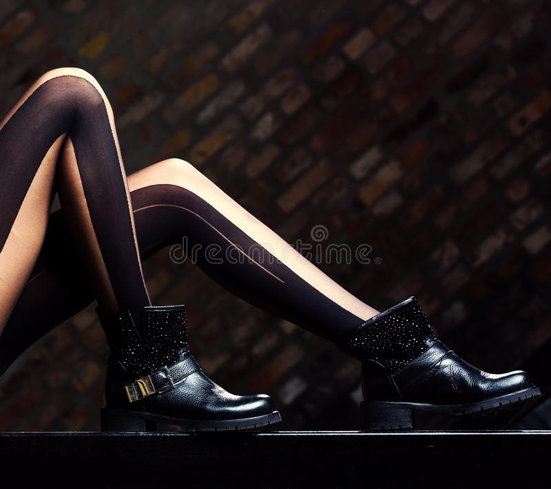 Female legs in leather boots royalty free stock images