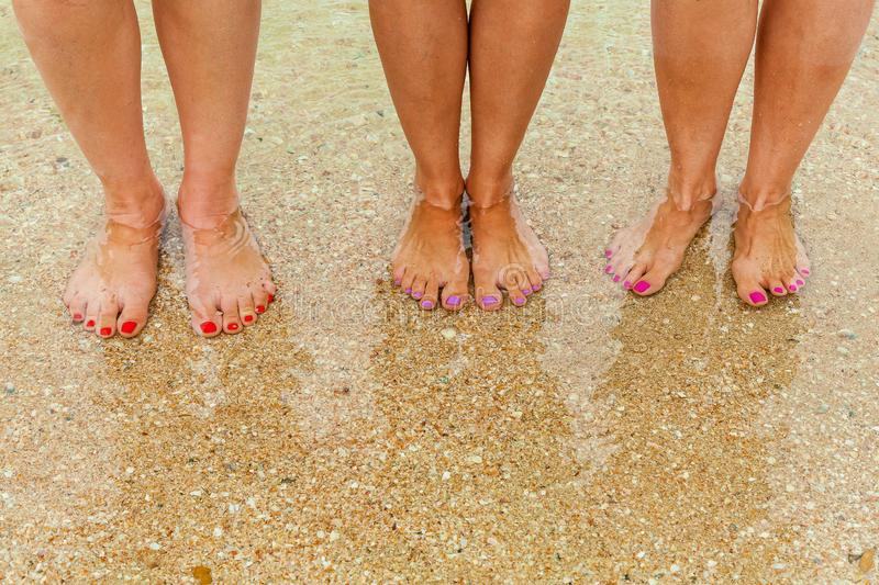 Female legs in clear water stock images