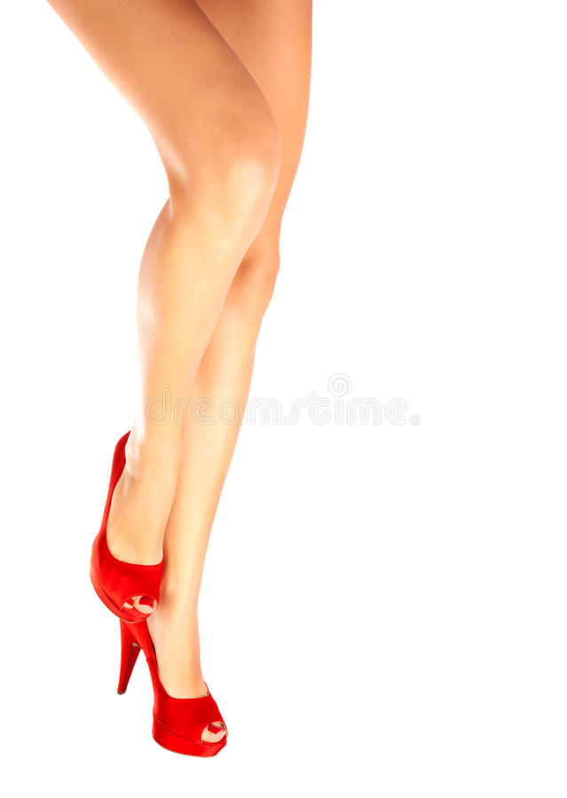 Female legs in red shoes royalty free stock images