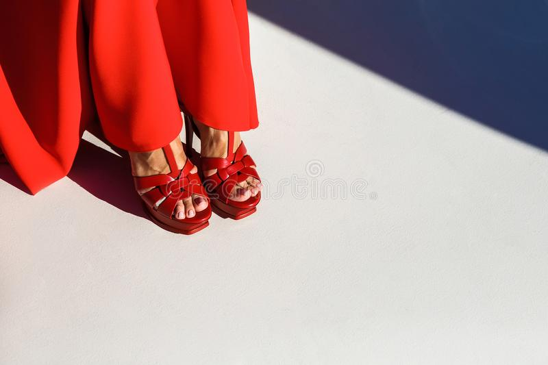 Female legs in red shoes on white background stock photos