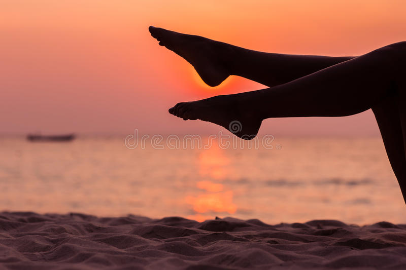 Female legs silhouette on sea background royalty free stock images