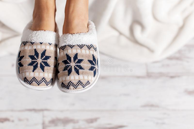 Female legs in slippers royalty free stock photography