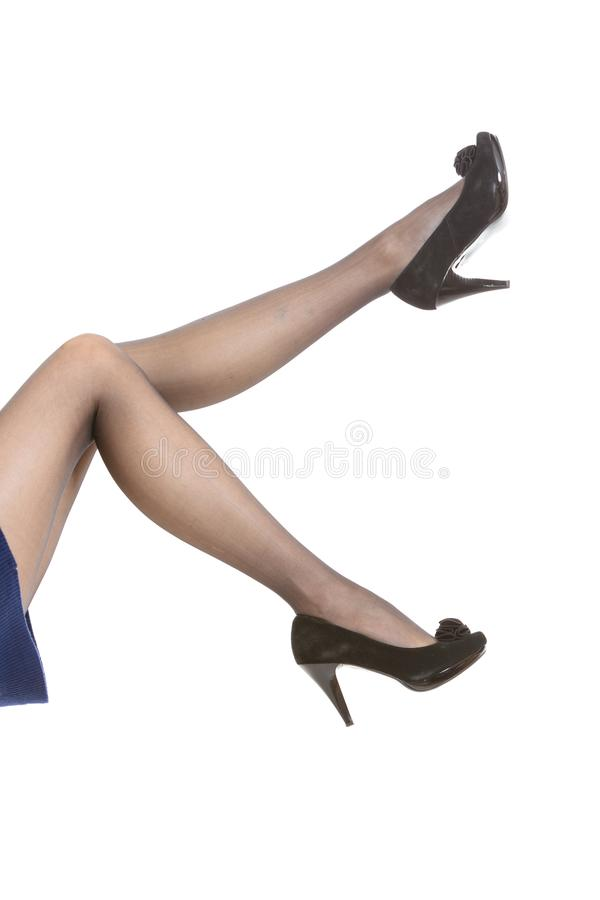 Female legs in tights and high heels royalty free stock image