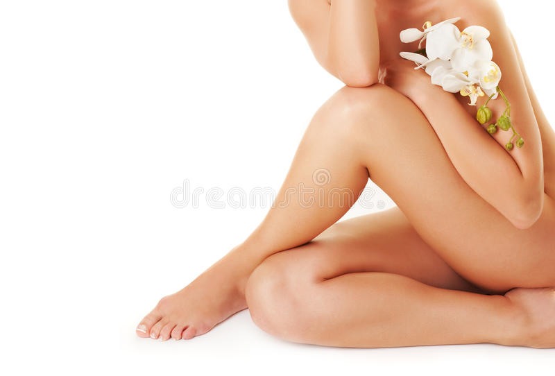 Download Female Legs With White Orchid Stock Image - Image: 9554561