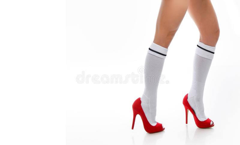 Womens legs and red shoes isolated on white background stock photos