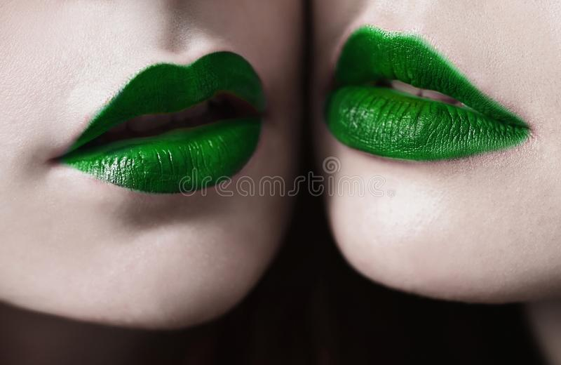 Female lips with matte lipstick closeup. Female lips with green matte lipstick closeup. Macro photo. Girls lesbians royalty free stock photos