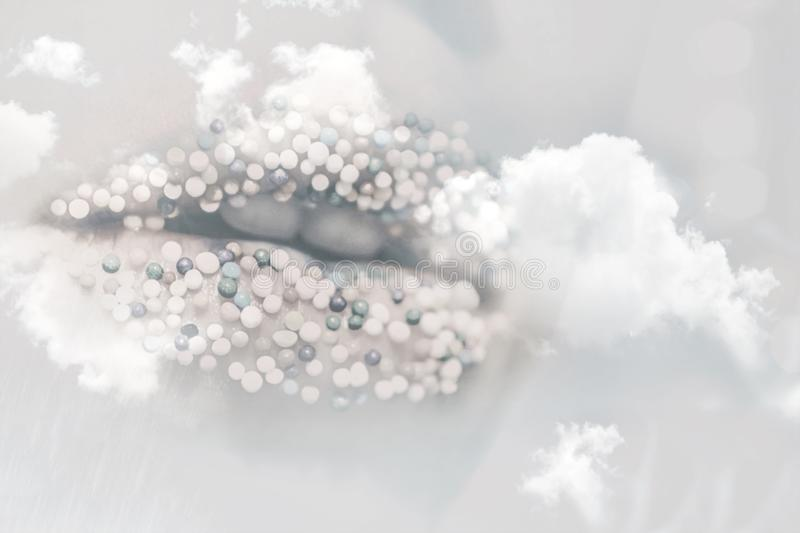 Female lips with sugar sprinkles. Background royalty free stock photography