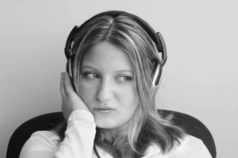 Female listening to headphones royalty free stock photography