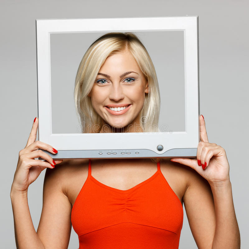 Female Looking Through The Screen Frame Royalty Free Stock Photography
