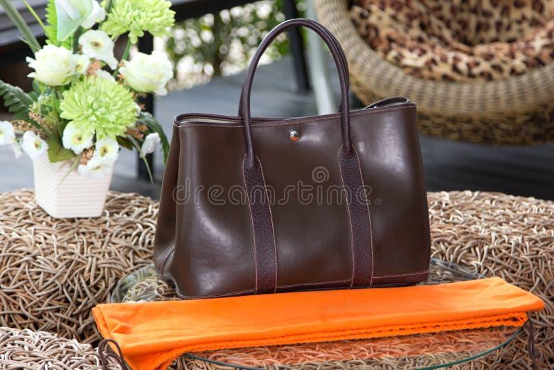 Female luxury personal fashion bag. Natural background stock image