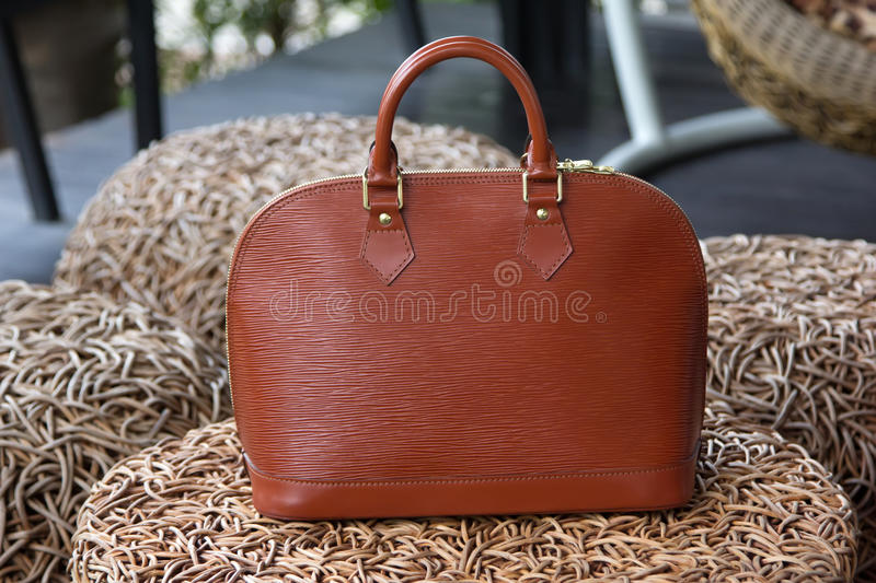 Female luxury personal fashion bag. Natural background stock photography