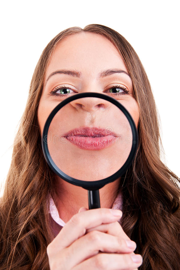 Female with magnifying glass royalty free stock photo