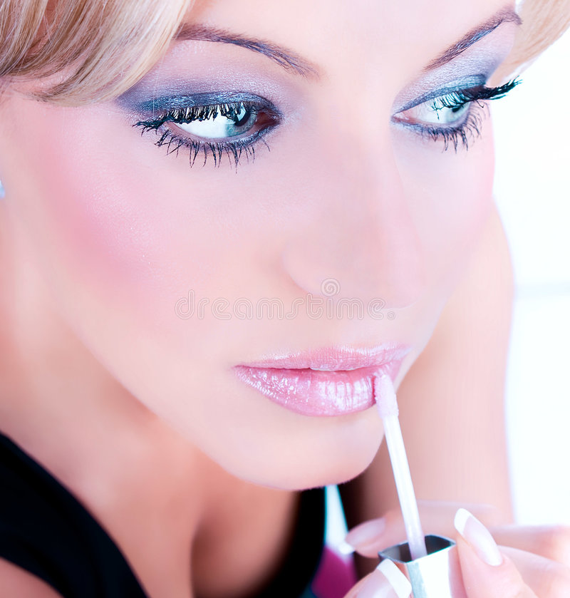 Female With  Makeup Applies A Slick Of  Lip Royalty Free Stock Image