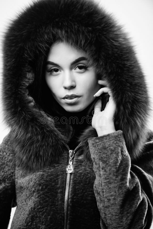 Female with makeup wear dark blue soft fur coat. Woman wear hood with fur. Fashion concept. Girl elegant lady wear stock images