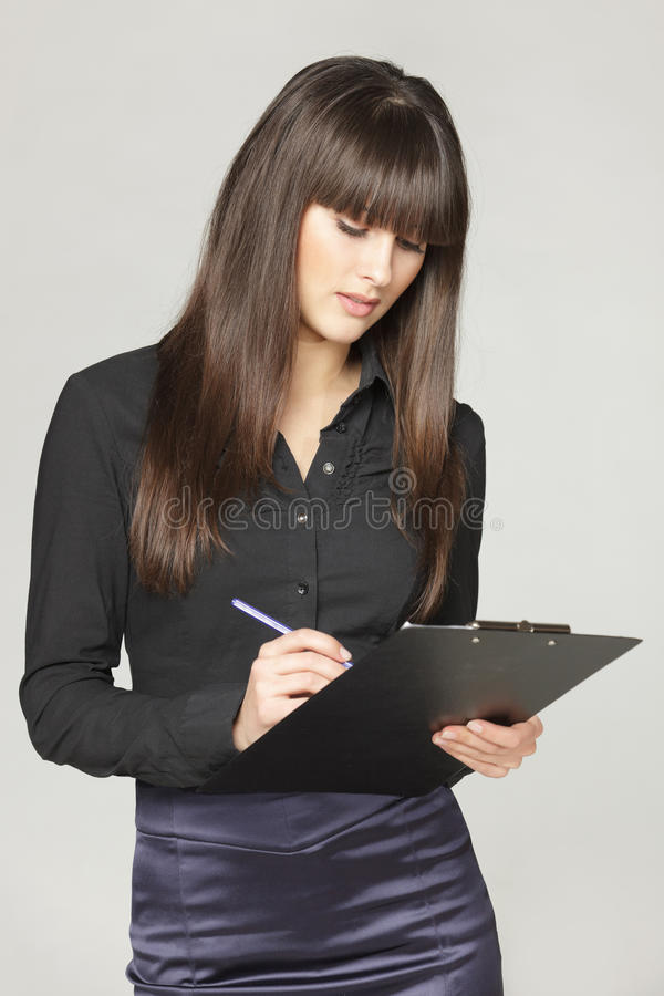 Download Female making notes stock photo. Image of friendly, gray - 23653462