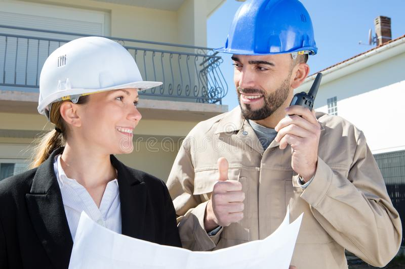 Female and male construction engineering occupation project stock images