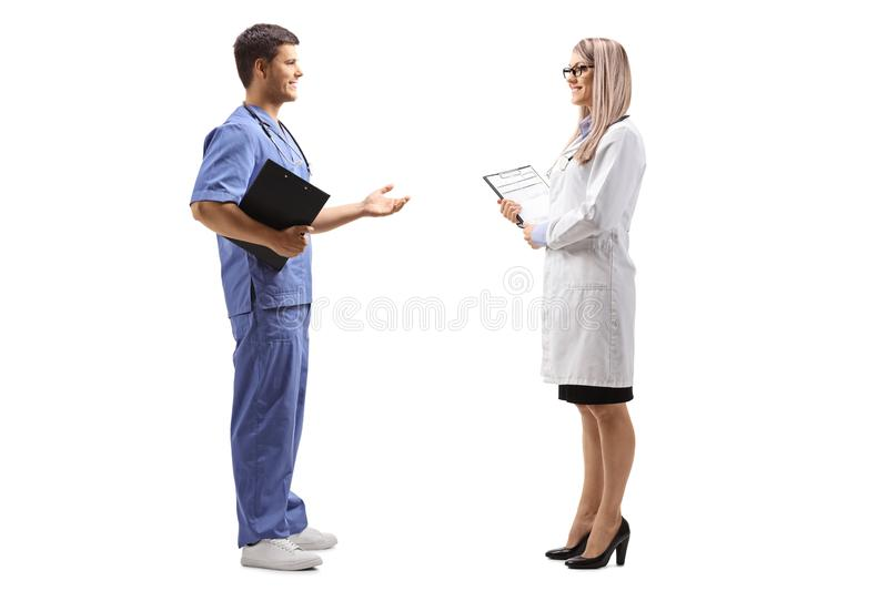 Female and male doctor having a conversation stock photography