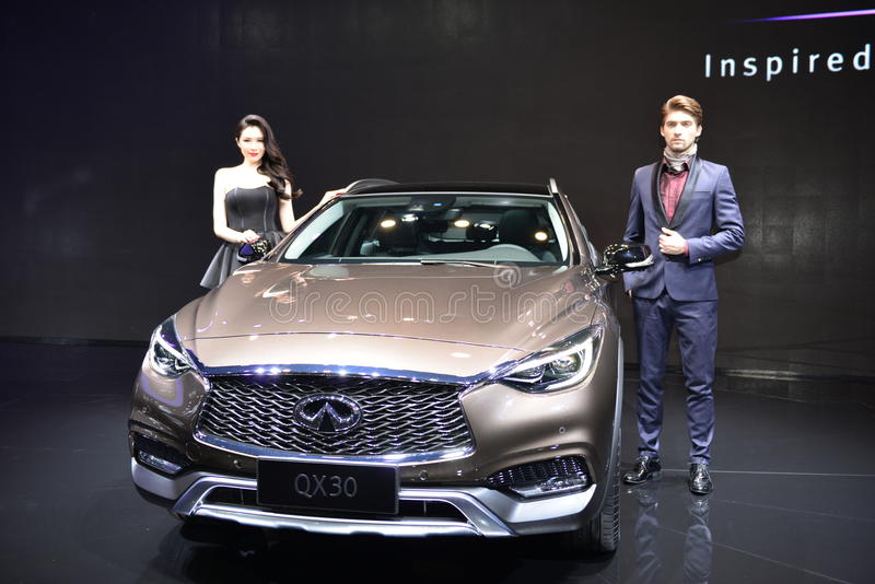 Female and Male Fashion Model on Infiniti QX30 SUV royalty free stock photos
