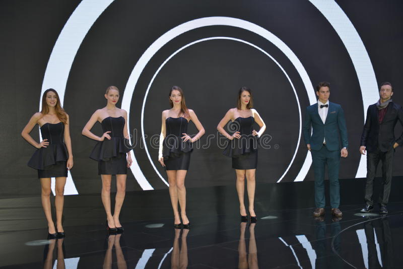 Female and Male Fashion Models in the booth of Infiniti stock photo