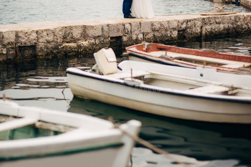 Female and male feet on the dock royalty free stock photography