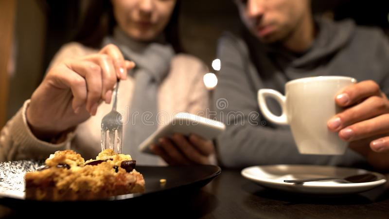 Female and male friends sitting in cafe, enjoying time together, conversation royalty free stock photo