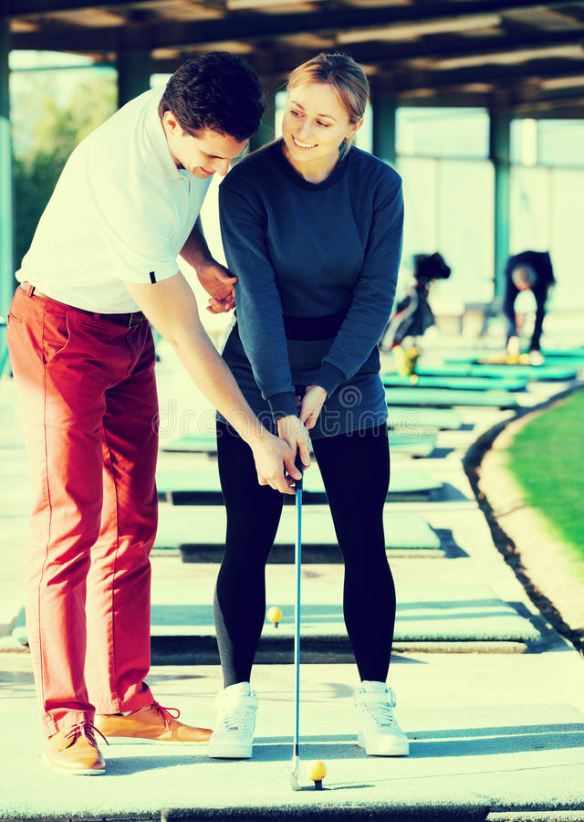 Female and male golfers are enjoying game stock photo