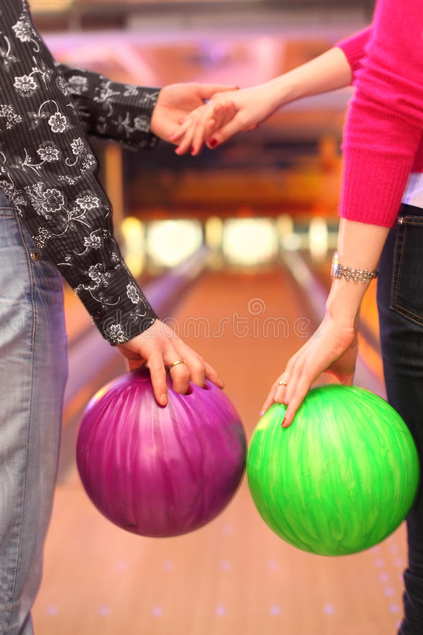 Download Female And Male Hands With Balls In Bowling Club Royalty Free Stock Images - Image: 23237969