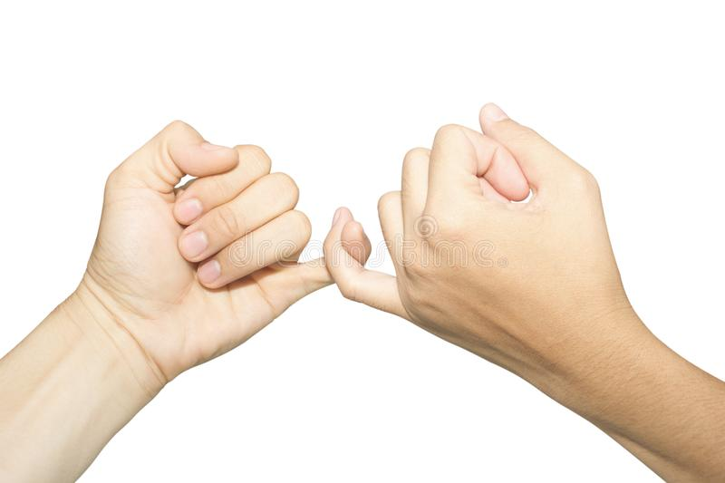 Female and male hands reconcile with clasping each other. `s little finger isolated on white, concept of promise royalty free stock images