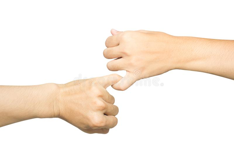 Female and male hands reconcile with clasping each other. `s little finger isolated on white, concept of promise royalty free stock image