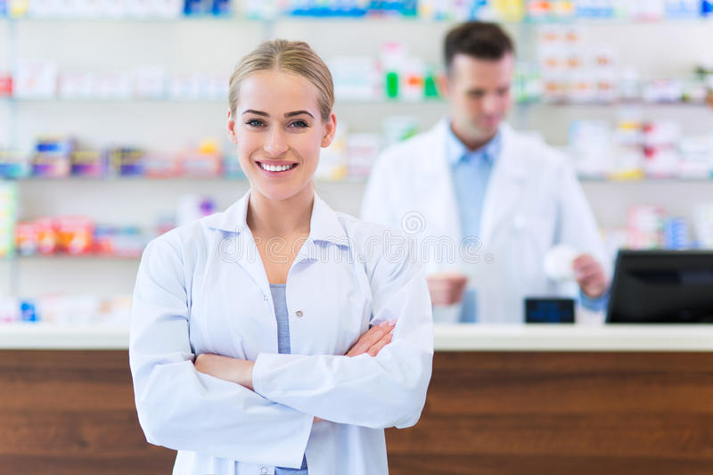 Female and male pharmacists. In pharmacy royalty free stock photo