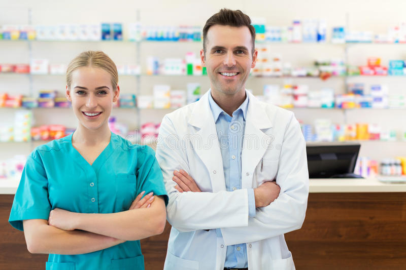 Female and male pharmacists royalty free stock photos