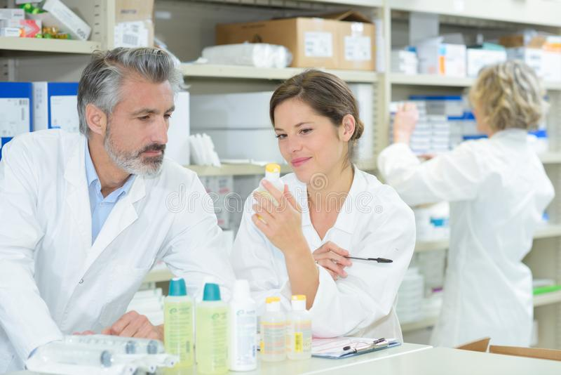 Female and male pharmacists in pharmacy royalty free stock images
