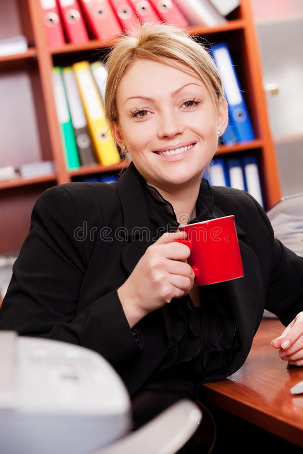 Female manager with coffee cup. Smiling female manager with coffee cup stock photo