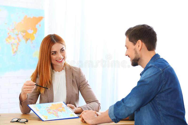 Female manager consulting client. In travel agency royalty free stock photos