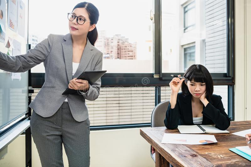 Female manager explaining her new project. Two professional businesswomen in the meeting room.female manager explaining her new project to her colleague. a royalty free stock photography