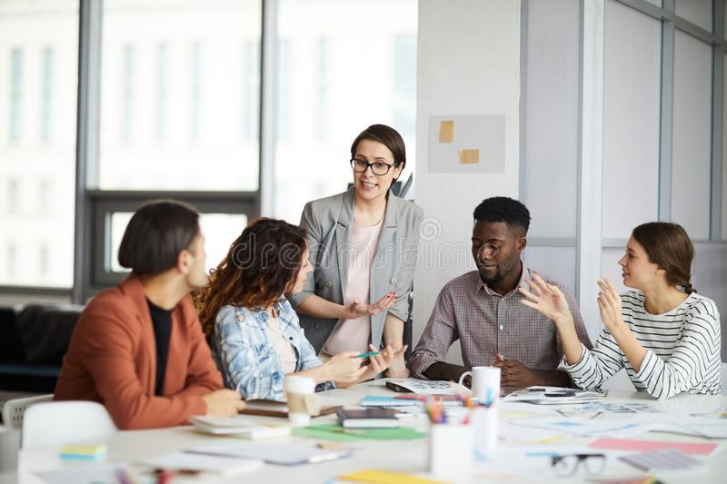 Female Manager Meeting with Creative Team stock photos