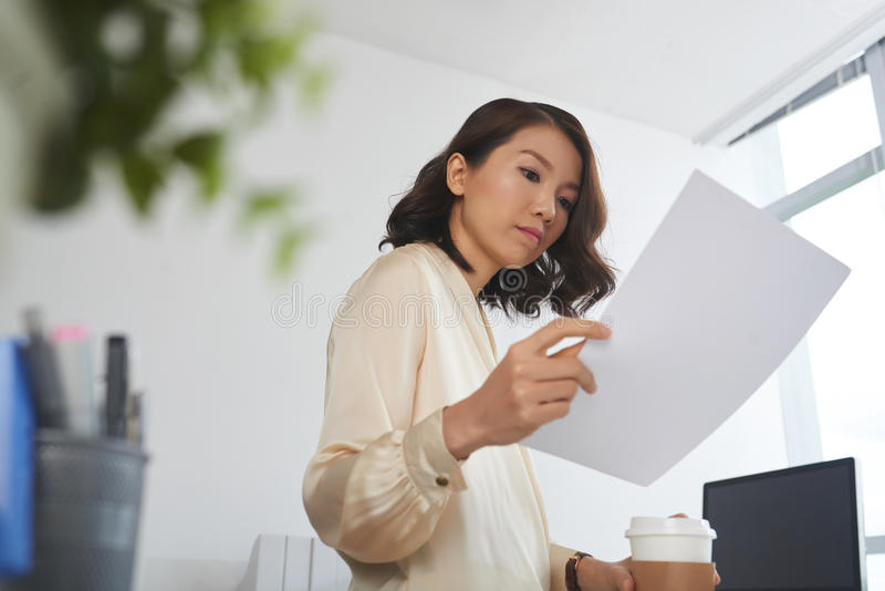 Female manager reading document royalty free stock image
