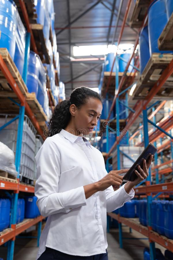 Female manager using digital tablet in warehouse. African American female manager using digital tablet in warehouse. This is a freight transportation and stock images
