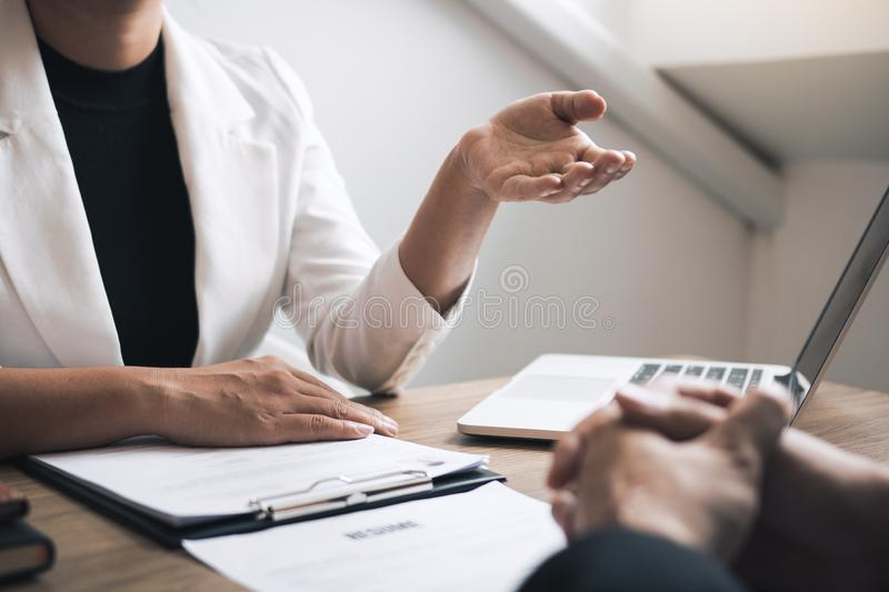Female managers are talking about the recruitment of staff at the office.  stock photos