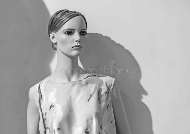 Female mannequin in a clothing store. Trading equipment - female plastic dummy royalty free stock image