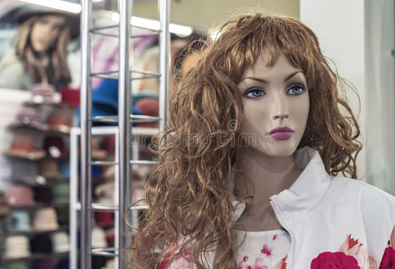 Female mannequin in a clothing store. Trading equipment - female plastic dummy royalty free stock photos