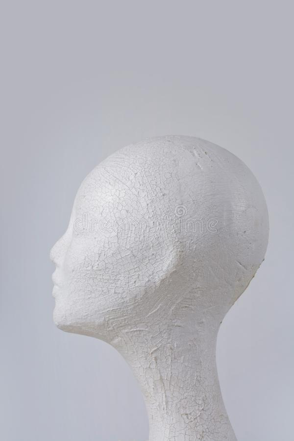 Female mannequin head cork in profile on gray background stock photography