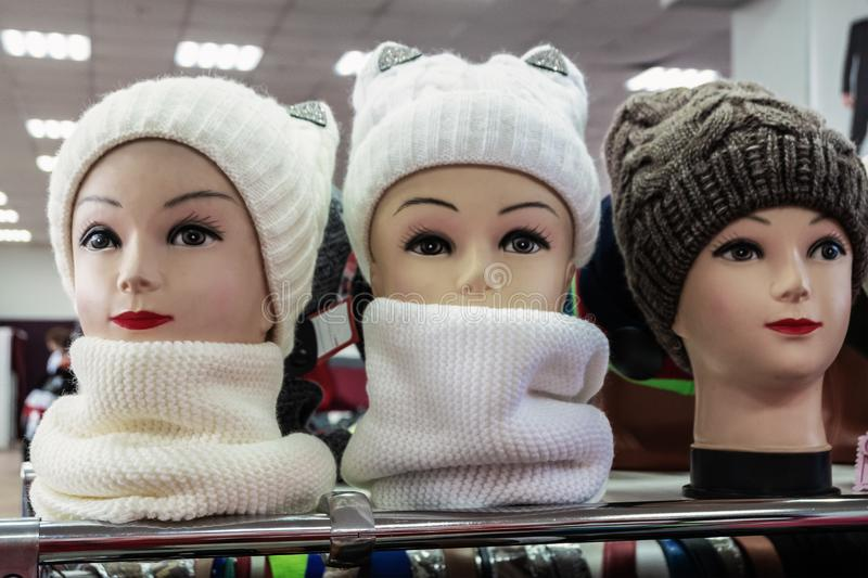 Female mannequin heads with knitted hats and scarves stock photos