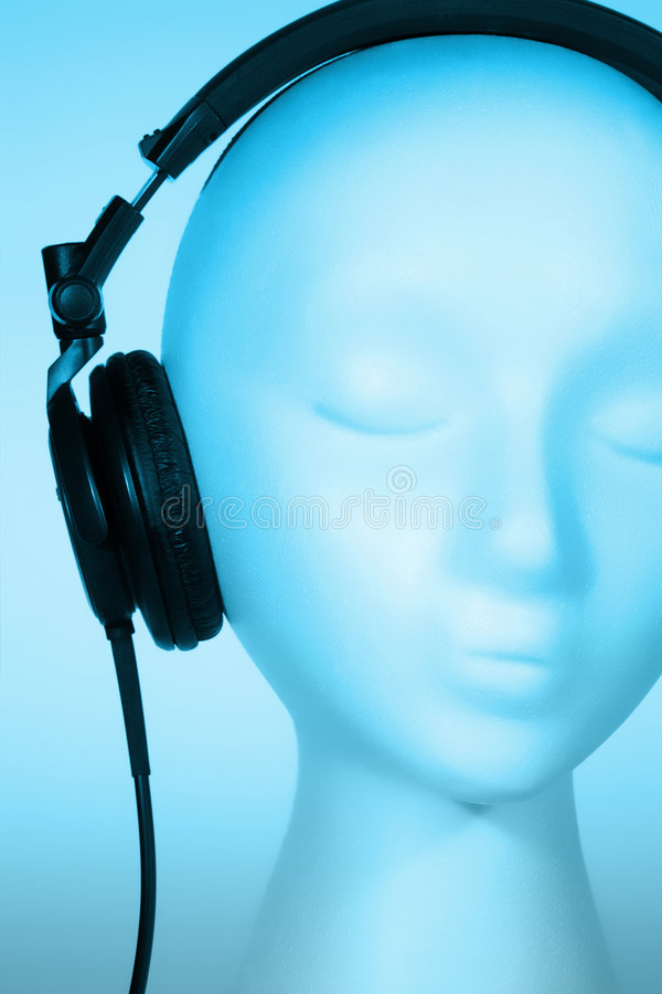 Female Mannequin listening to Music royalty free stock image